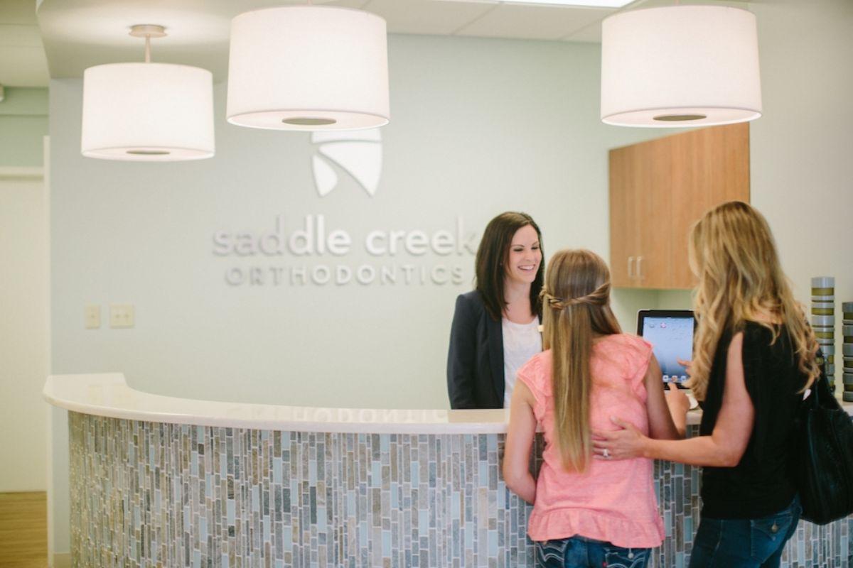 Patients at the Saddle Creek Orthodontics front desk